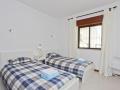 Deuxième chambre avec un espace pour un lit supplémentaire.